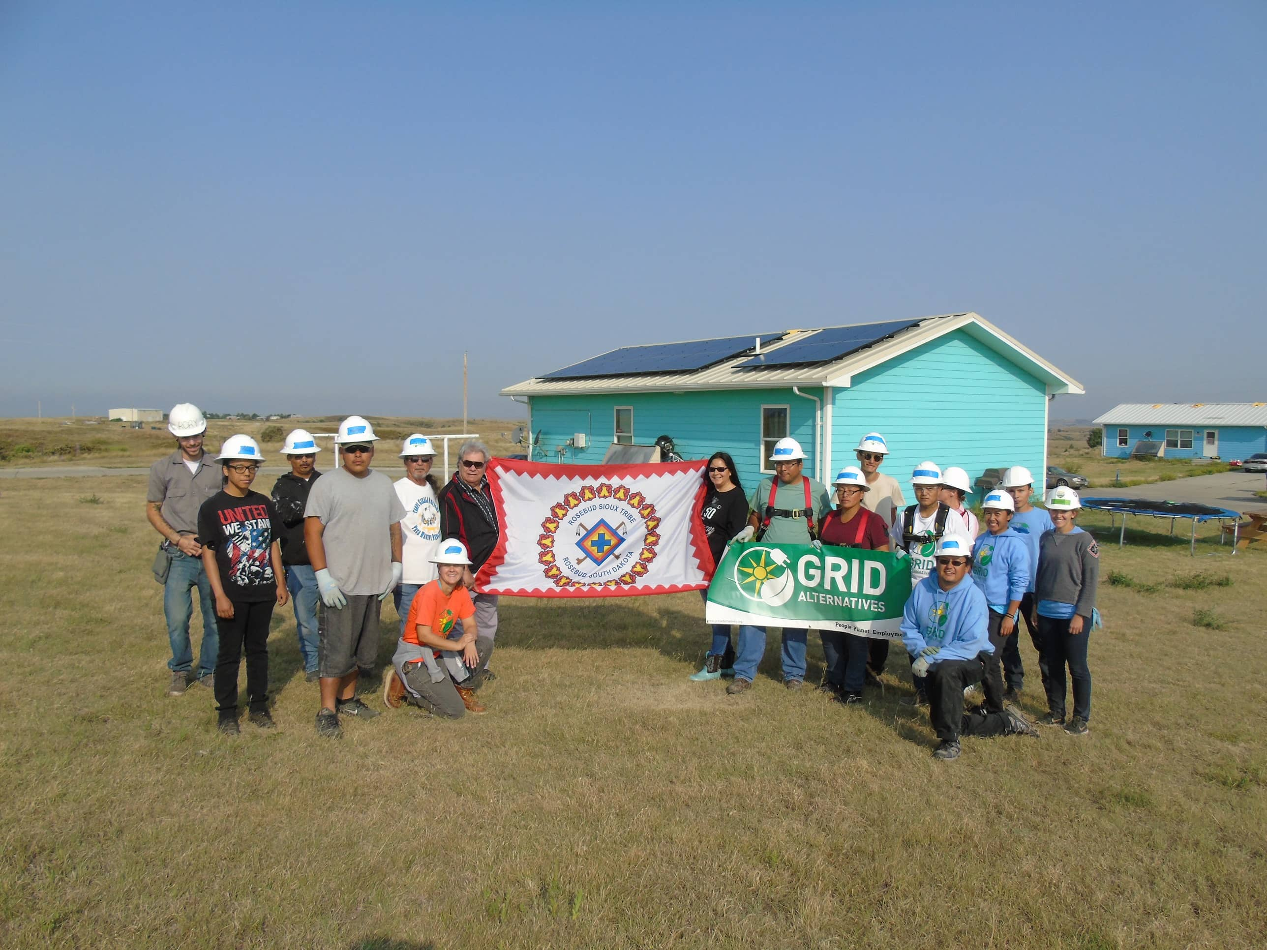 Celebration-with-volunteers-students-Housing-Authority-staff-and-GRID-staff Nonprofit, Feds Partner To Provide Solar On U.S. Tribal Lands