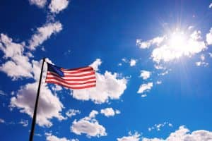 Flag of the United States against sky
