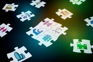 Jigsaw puzzle pieces, various electric energy icons are printed, smart grid, conceptual abstract image