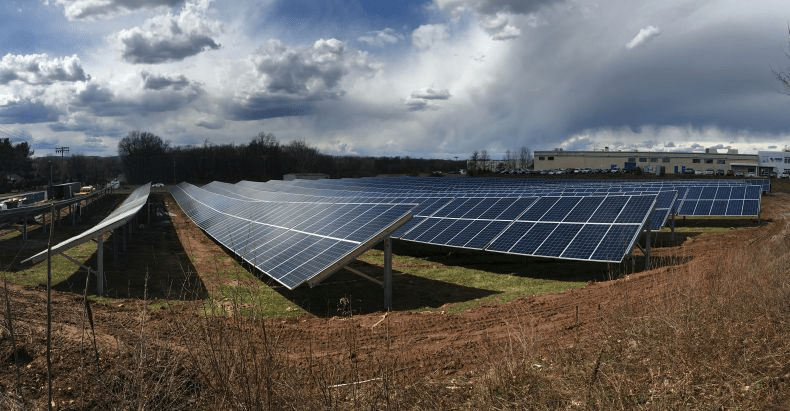 TOMZ-Ground1 Connecticut Manufacturer Turns On 1.12 MW Solar Project