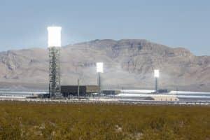 Ivanpah, California, USA - May 14, 2014:  Three glowing white hot towers at the newly operational 392 megawatt Ivanpah solar thermal power plant in California's Mojave desert.